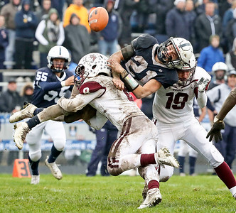 Kyle Koelblinger (8) from Prairie Ridge makes the final tackle of the game upending Danny Daigle (21) from Cary-Grove during the fourth quarter of their IHSA Class 6A playoff game at Cary-Grove High School on Saturday, November 4, 2017 in Cary, Illinois. The Wolves defeated the Trojans 17-13. John Konstantaras photo for Shaw Media