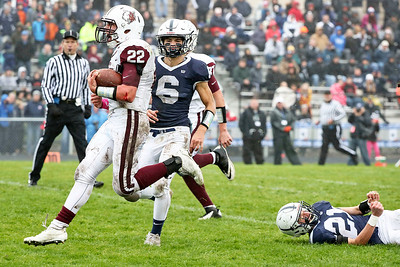Samson Evans (22) from Prairie Ridge runs past Benjamin Ferrell (6) and Danny Daigle (21) from Cary-Grove for a touchdown during the first quarter of their IHSA Class 6A playoff game at Cary-Grove High School on Saturday, November 4, 2017 in Cary, Illinois. The Wolves defeated the Trojans 17-13. John Konstantaras photo for Shaw Media