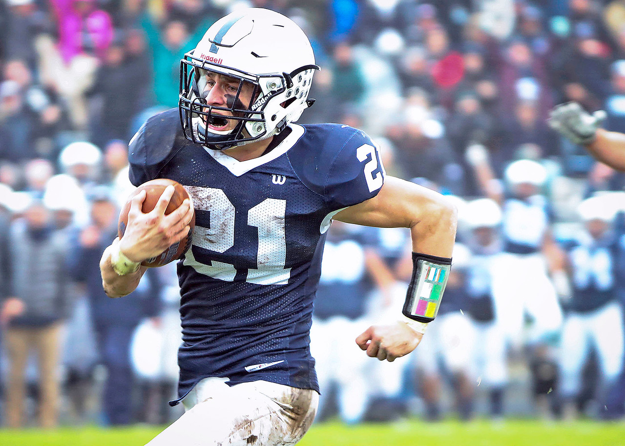 Danny Daigle (21) from Cary-Grove runs for a touchdown during the second quarter of their IHSA Class 6A playoff game against Prairie Ridge at Cary-Grove High School on Saturday, November 4, 2017 in Cary, Illinois. The Wolves defeated the Trojans 17-13. John Konstantaras photo for Shaw Media