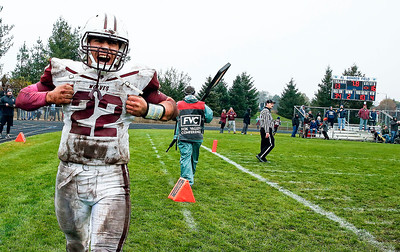 Samson Evans (22) from Prairie Ridge celebrates after scoring the game winning touchdown during the fourth quarter of their IHSA Class 6A playoff game against Cary-Grove on Saturday, November 4, 2017 in Cary, Illinois. The Wolves defeated the Trojans 17-13. John Konstantaras photo for Shaw Media