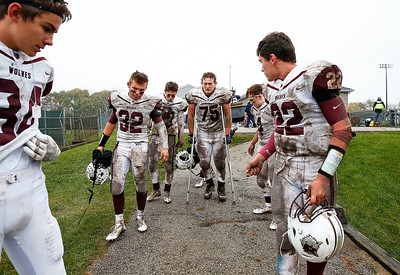 Riley Smith (75) from Prairie Ridge walks off the field with his teammates after being injured during the 17-13 IHSA Class 6A playoff victory over Cary-Grove on Saturday, November 4, 2017 in Cary, Illinois.  John Konstantaras photo for Shaw Media