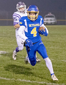 Johnsburg High School senior Trent Hauck carries the ball during the Class 4A second round playoff game against Rochelle Saturday, November 4, 2017 in Johnsburg. Rochelle went on to upset the Skyhawks 35-16.  KKoontz – For Shaw Media