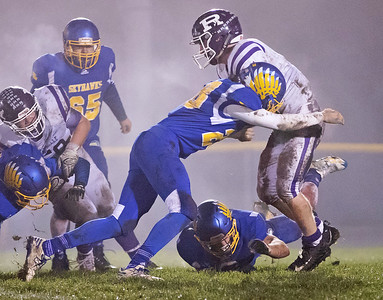 Johnsburg High School senior Brody Frazier makes a tackle during the Class 4A second round playoff game against Rochelle Saturday, November 4, 2017 in Johnsburg. Rochelle went on to upset the Skyhawks 35-16.  KKoontz – For Shaw Media