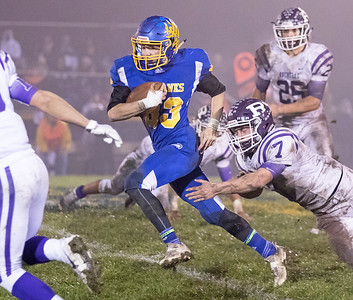Johnsburg High School senior Jesse Mercado carries the ball during the Class 4A second round playoff game against Rochelle Saturday, November 4, 2017 in Johnsburg. Rochelle went on to upset the Skyhawks 35-16.  KKoontz – For Shaw Media
