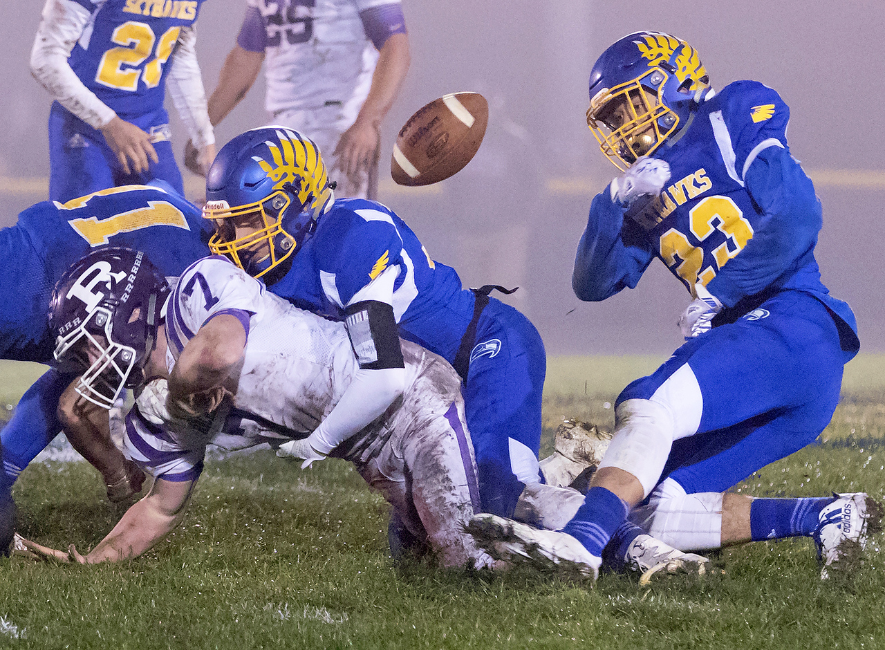 Johnsburg High School senior Brody Frazier (23) strips the ball away from Rochelle running back Ehren Metzger during the Class 4A second round playoff game Saturday, November 4, 2017 in Johnsburg. Johnsburg recovered the fumble but it wasn't enough as Rochelle went on to upset the Skyhawks 35-16.  KKoontz – For Shaw Media