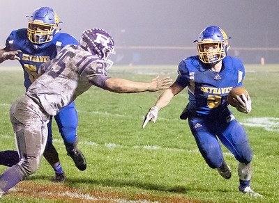 Johnsburg High School senior Jack Kegel carries the ball during the Class 4A second round playoff game against Rochelle Saturday, November 4, 2017 in Johnsburg. Rochelle went on to upset the Skyhawks 35-16.  KKoontz – For Shaw Media