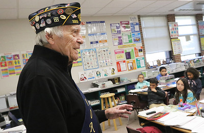 Candace H. Johnson-For Shaw Media Don Carter, 92, of Libertyville, an Army veteran who was a member of the 44th Field Artillery Battalion, 4th Infantry Division, during World War II talks to third grade students about storming Normandy as he spoke in honor of Veterans Day at Gavin Central Elementary School in Ingleside.(11/10/17)