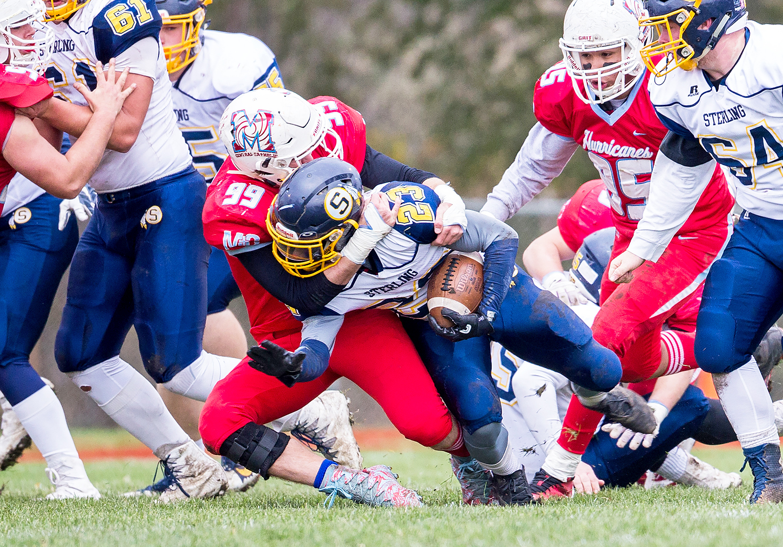 Marian Central Catholic senior Ben Keller (99) tackles Sterling's Nyrel Sullivan (23) for a loss during the Class 5A state quarterfinal game against Sterling Saturday, November 11, 2017 in Woodstock. The Hurricanes come up short falling to Sterling 22-10. KKoontz- For Shaw Media