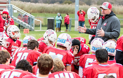 Marian Central Catholic football coach Mike Maloney talks with his team after falling to Sterling in the Class 5A state quarterfinal game Saturday, November 11, 2017 in Woodstock. Sterling wins 22-10 and advances to the State Semi-Finals. KKoontz- For Shaw Media