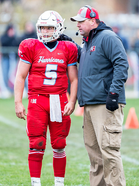 Marian Central Catholic football coach Mike Maloney gives a play to senior quarterback Gavin Scott during the Class 5A state quarterfinal game against Sterling Saturday, November 11, 2017 in Woodstock. The Hurricanes come up short falling to Sterling 22-10. KKoontz- For Shaw Media