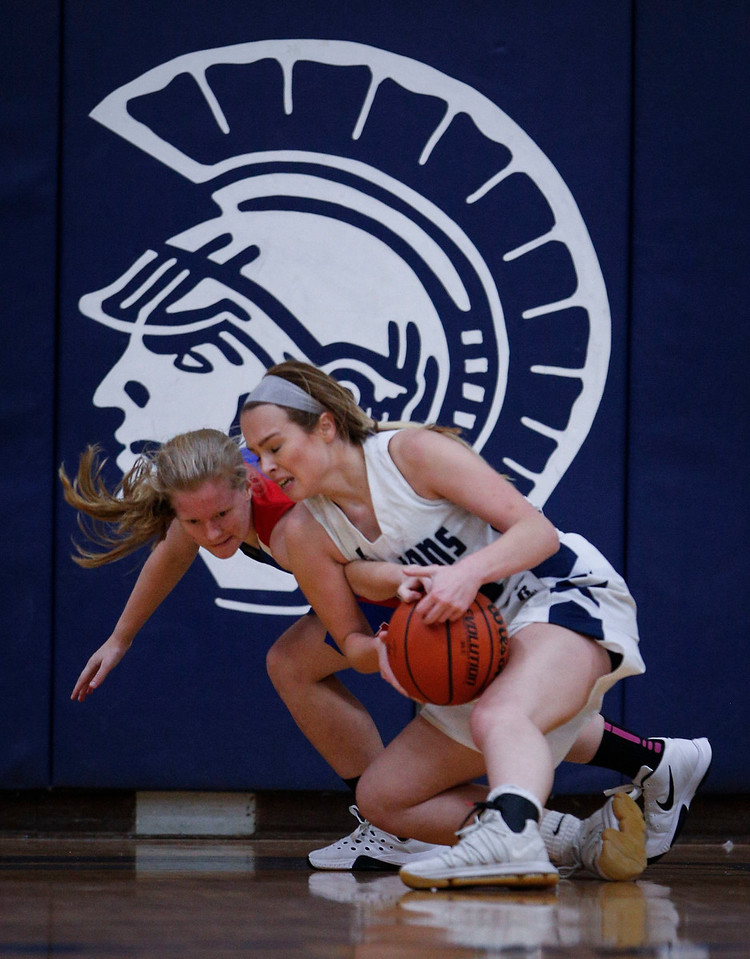 Ally Raupp (33) from Cary-Grove battles for a loose ball with Anna Wallenfang (11) from Lakes during the third quarter of their game at Cary-Grove High School on Monday, November 13, 2017 in Cary, Illinois. The Trojans defeated the Eagles 47-22. John Konstantaras photo for Shaw Media