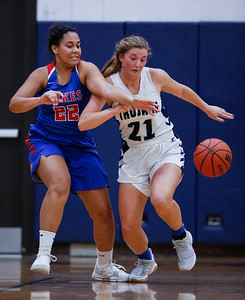 Katie Sowa (21) from Cary-Grove steals the ball from Mia Edwards (22) from Lakes during the fourth quarter of their game at Cary-Grove High School on Monday, November 13, 2017 in Cary, Illinois. The Trojans defeated the Eagles 47-22. John Konstantaras photo for Shaw Media