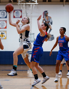Elsa Larry (22) from Cary-Grove drives to the basket past Taylor Lehman (24) from Lakes during the second quarter of their game at Cary-Grove High School on Monday, November 13, 2017 in Cary, Illinois. The Trojans defeated the Eagles 47-22. John Konstantaras photo for Shaw Media