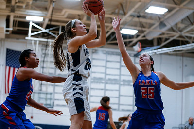 Abby Getka (20) from Cary-Grove shoots over Kylie Jozwik (25) from Lakes during the fourth quarter of their game at Cary-Grove High School on Monday, November 13, 2017 in Cary, Illinois. The Trojans defeated the Eagles 47-22. John Konstantaras photo for Shaw Media