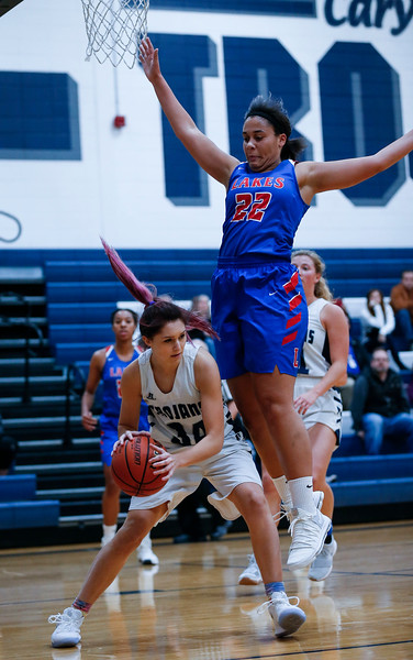 Mia Edwards (22) from Lakes jumps to defend Maddie Gorz (34) from Cary-Grove during the first quarter of their game at Cary-Grove High School on Monday, November 13, 2017 in Cary, Illinois. The Trojans defeated the Eagles 47-22. John Konstantaras photo for Shaw Media