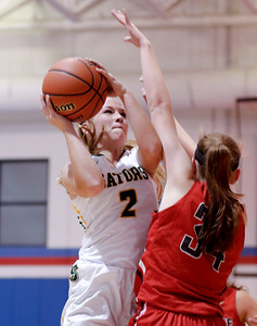 Sarah Nader - snader@shawmedia.com Crystal Lake South's Maddie Bush shoots over Palatine's Sydney Rzepka during the third quarter at Friday's Dundee-Crown Girls Basketball Thanksgiving Tournament Nov. 17, 2017. Crystal Lake South lost in overtime, 40-41.