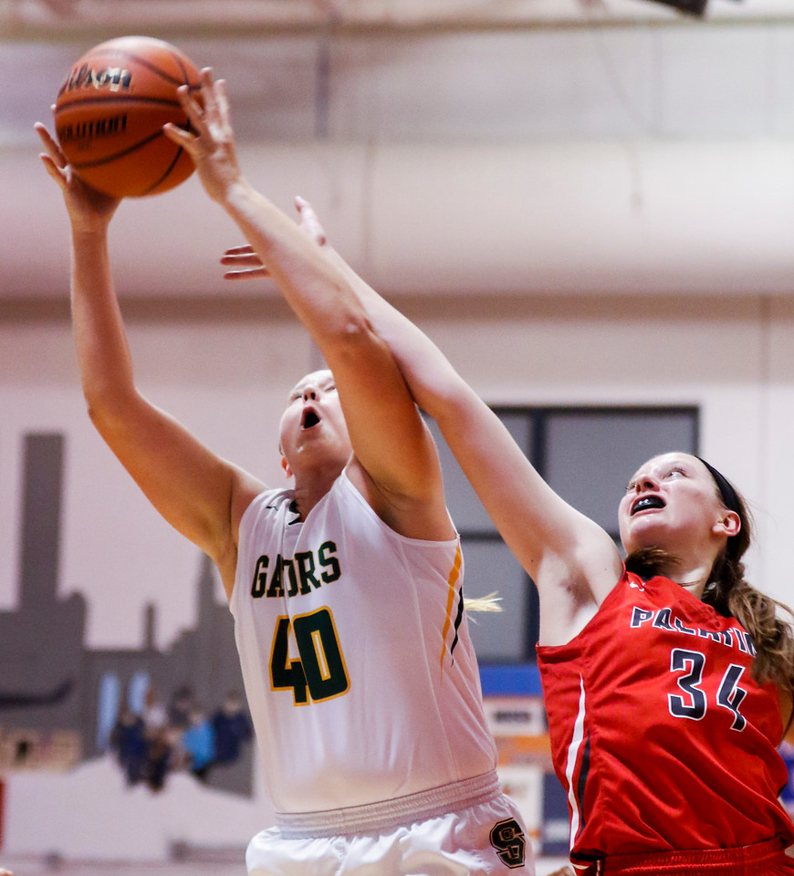 Sarah Nader - snader@shawmedia.com Crystal Lake South's Emily Sulikowski (left) and Palatine's Sydney Rzepka reach for the rebound during the second quarter at Friday's Dundee-Crown Girls Basketball Thanksgiving Tournament Nov. 17, 2017. Crystal Lake South lost in overtime, 40-41.