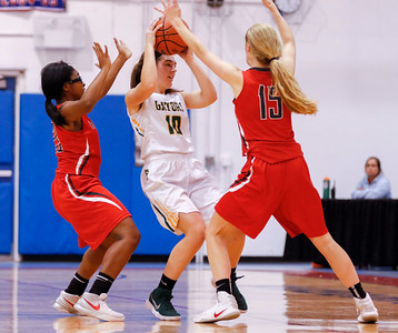 Sarah Nader - snader@shawmedia.com Crystal Lake South's Lauren Schoen (center) passes the ball during the third quarter of Friday's game against Palatine at the Dundee-Crown Girls Basketball Thanksgiving Tournament Nov. 17, 2017. Crystal Lake South lost in overtime, 40-41.