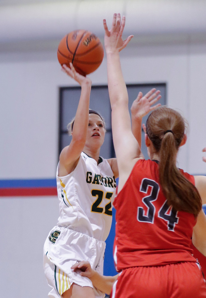 Sarah Nader - snader@shawmedia.com Crystal Lake South's Ava Sevcik shoots over Palatine's Sydney Rzepka during the third quarter at Friday's Dundee-Crown Girls Basketball Thanksgiving Tournament Nov. 17, 2017. Crystal Lake South lost in overtime, 40-41.