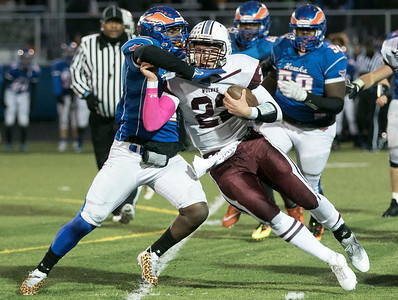 Sarah Nader - snader@shawmedia.com Prairie Ridge's Samson Evans pushes off Hoffman Estates'  Jaylan Alexander during the second quarter at Saturday's Class 6A state semifinal game in Hoffman Estates Nov. 18, 2017. Prairie Ridge won, 42-21.