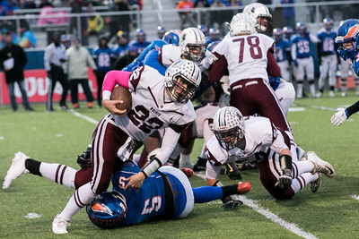 Sarah Nader - snader@shawmedia.com Prairie Ridge's Samson Evans is tackled by Hoffman Estates' Shawn Brown during the first quarter at Saturday's Class 6A state semifinal game in Hoffman Estates Nov. 18, 2017. Prairie Ridge won, 42-21.