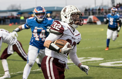Sarah Nader - snader@shawmedia.com Prairie Ridge's Zach Gulbransen runs the ball during the first quarter at Saturday's Class 6A state semifinal game against Hoffman Estates Nov. 18, 2017. Prairie Ridge won, 42-21.