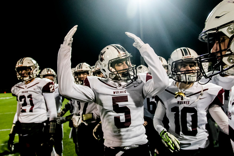 Sarah Nader - snader@shawmedia.com Prairie Ridge's Charles Salerno (center) celebrates with the football team during the final seconds of Saturday's Class 6A state semifinal game against Hoffman Estates Nov. 18, 2017. Prairie Ridge won, 42-21.