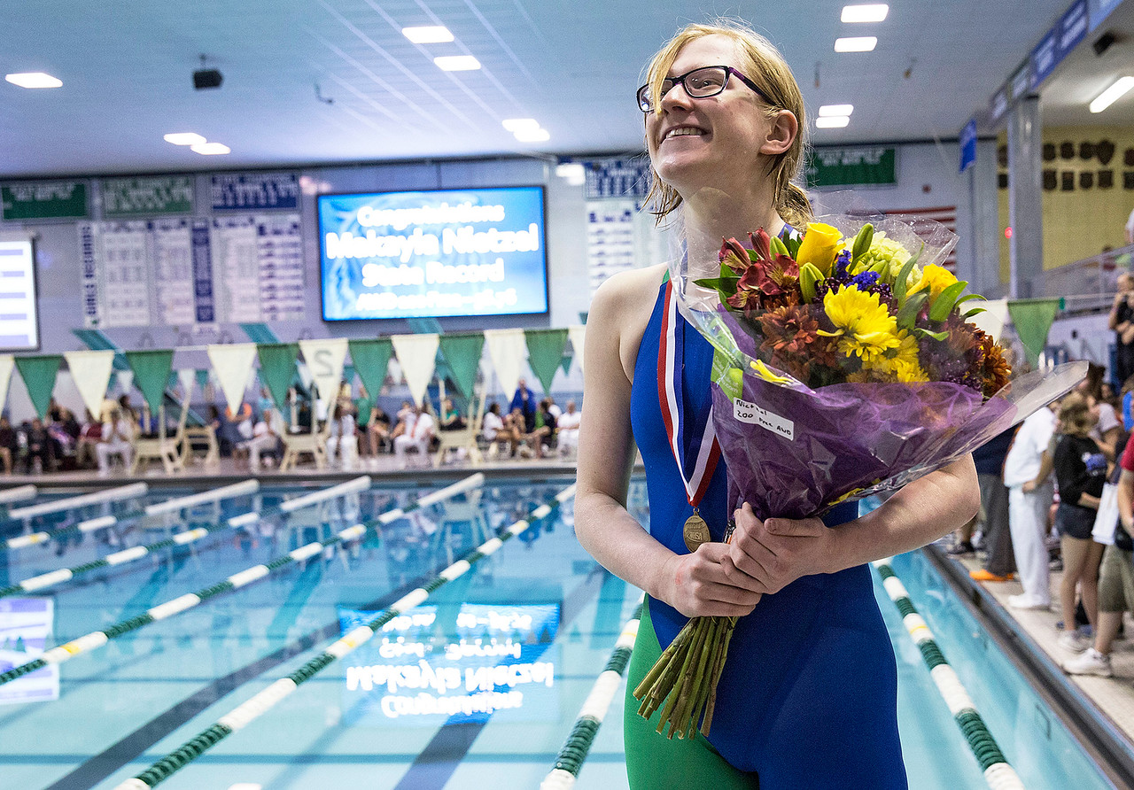 Makayla Nietzel, Crystal Lake Coop, on the award stand for her first place medal in the 100-yard freestyle during the IHSA Swimming and Diving Championships at New Trier High School on Saturday, November 18, 2017 in Winnetka, Illinois. Nietzel brought home four championships in her students with Physical/Visual Disabilities races. John Konstantaras photo for Shaw Media