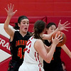 Batavia forward Geddy Rerko (42) presses Naperville Central forward Lucy Schmid (23) at Naperville Central in Naperville on Nov. 17.