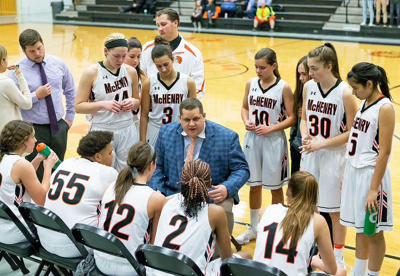 McHenry High School girls' basketball Head Coach Rob Niemic talks with his team during a timeout Tuesday, November 28, 2017 in McHenry. The Warriors went on to beat Prairie Ridge 68-56. KKoontz – For Shaw Media