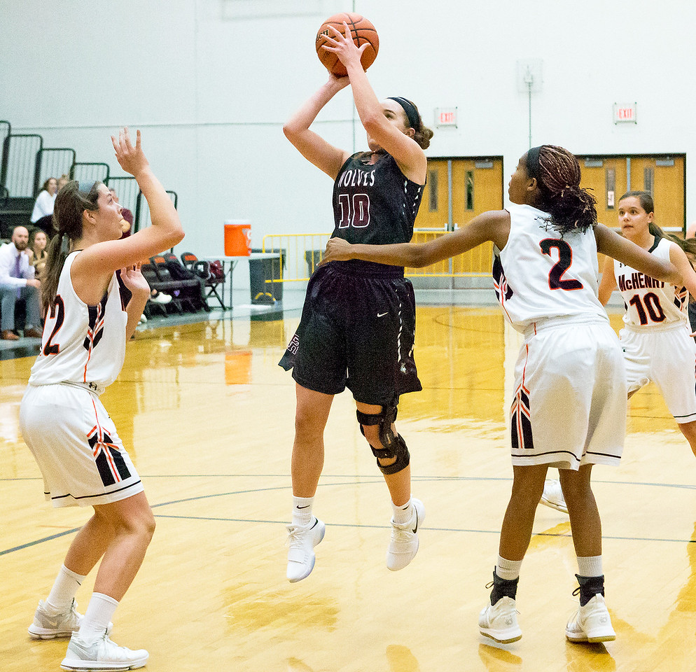 Prairie Ridge's Karly Statter drives the lane against McHenry Tuesday, November 28, 2017 in McHenry. Though Statter led the Wolves with 24pts. McHenry goes on to win 68-56. KKoontz – For Shaw Media