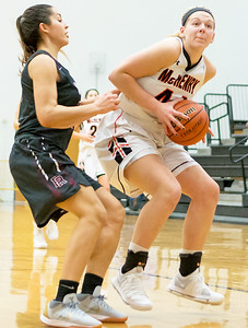 McHenry's Elizabeth Alsot posts up under the basket Tuesday, November 28, 2017 in McHenry. Alsot finished the game with 15 rebounds in the 68-56 victory over Prairie Ridge. KKoontz- For Shaw Media