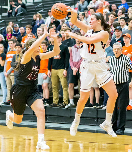 McHenry's Aannah Interrante makes a quick pass over Prairie Ridge's Victoria Fisher Tuesday, November 28, 2017 in McHenry. McHenry went on to win 68-56 and Interrante finshed with 13pts.  KKoontz – For Shaw Media