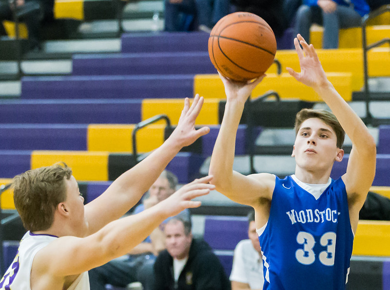 Ken Koontz - for Shaw Media With just seconds remaining in the game, Woodstock's Michael Gardner hits the game winning shot against Wauconda, giving the Blue Streaks the 68-66 victory. The win on the road against Wauconda held Wednesday, November 29, 2017 in Wauconda was the first victory of the year for Woodstock.  KKoontz- For Shaw Media