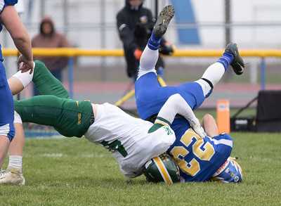 Johnsburg's Jacob McKinney gets up-ended by Coal City defender Kyle Burch in the second-round Class 4A playoff game Saturday, November 3, 2018 in Johnsburg. Coal City went on to win the game 33-14 and will face Richmond-Burton next week.  KKoontz –For Shaw Media