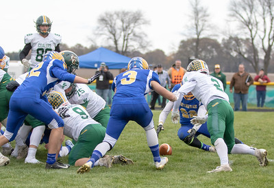 Johnsburg's Max Kegel and Casey Meland recover a Coal City fumble during the second-round Class 4A playoff game Saturday, November 3, 2018 in Johnsburg. Coal City went on to win the game 33-14 and will face Richmond-Burton next week.  KKoontz –For Shaw Media
