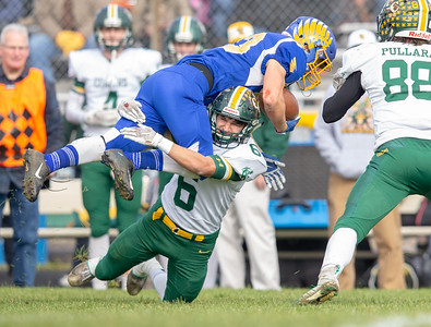 Johnsburg's Jacob McKinney gets up-ended by Coal City's Maxwell Arias in the second-round Class 4A playoff game Saturday, November 3, 2018 in Johnsburg. Coal City went on to win the game 33-14 and will face Richmond-Burton next week.  KKoontz –For Shaw Media