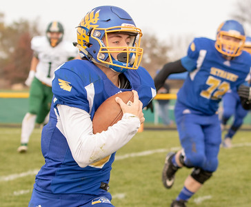 Johnsburg quarterback Jonathan Preston breaks to the outside against Coal City during the second-round Class 4A playoff game Saturday, November 3, 2018 in Johnsburg. Coal City went on to win the game 33-14 and will face Richmond-Burton next week.  KKoontz –For Shaw Media