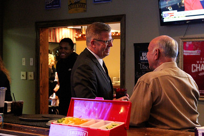 U.S. Rep. Randy Hultgren (R-Plano) (center) chatted up supporters in the bar of Kennedy Pointe Restaurant and Pub in Bristol on Tuesday night, as visitors kept a close watch on incoming election results from Kane and Kendall Counties.