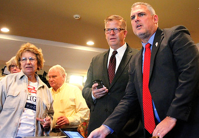 U.S. Rep. Randy Hultgren (R-Plano) (center) and State Rep. Keith Wheeler (R-Oswego) (right) check the incoming election results on election night during a gathering at Kennedy Pointe Restaurant and Pub in Bristol on Tuesday night.