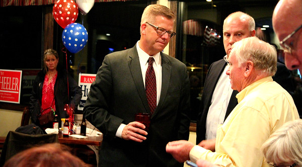 U.S. Rep. Randy Hultgren (R-Plano) (center) listened to voters and supporters as they discussed several referendums that appeared on the ballot in Kendall County or in Kane County during an election watch party at Kennedy Pointe Restaurant and Pub in Bristol on Tuesday night.