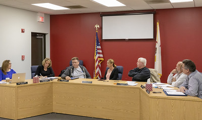 Lake in the Hills Sanitation Board attorney Ann Williams (Left) answers a question from Board Trustee Terry Easler concerning the cost of a consolidation study Thursday, November 8, 2018 in Lake in the Hills. KKoontz- For Shaw Media