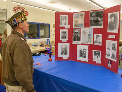 United States Air Force Veteran Gregg Sielepkowski reads a display honoring veterans that was created by Michael Ryan, a student at Northwood Elementary School in Woodstock, during the Kids and Veterans Awards Ceremony held Thursday, November 8, 2018. KKoontz – For Shaw Media