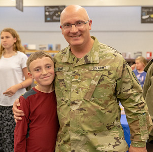 Brier Blue (11yrs) from Wonder Lake poses for a photo with his father, Army National Guard Major Marc Blue, at the Kids and Veterans Awards Ceremony held Thursday, November 8, 2018 at Northwood Elementary School in Woodstock. KKoontz – For Shaw Media
