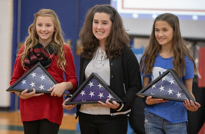 Flags that were flown over the nation's capital were presented to Sydney Wiegel (L-R) (6th Grade), Kirsten Carroll (7th Grade) and Charlotte Noshay (8th Grade) – winners of the Excellence in Writing Competition at Northwood Elementary School in Woodstock Thursday, November 8, 2018.  KKoontz- For Shaw Media