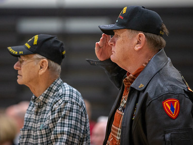 Marine Veteran Paul Whittenhall salutes during the playing of the Marine Hymn Friday, November 9, 2018 at the Veterans Memorial Ceremony held at McHenry County College in Crystal Lake. KKoontz- For Shaw Media