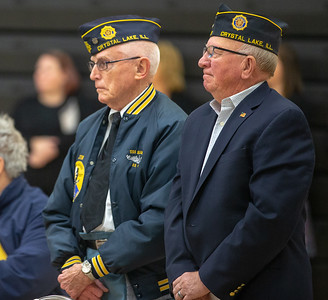 United States Navy veterans Jim Dyson (Left) and Tom Allig stand during the playing of the Navy Hymn Friday, November 9, 2018 at the Veterans Memorial Ceremony held at McHenry County College in Crystal Lake. KKoontz- For Shaw Media