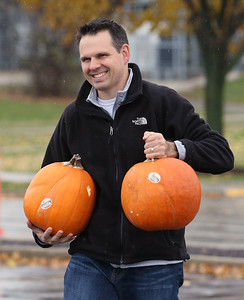 Candace H. Johnson-For Shaw Media Chris Sikorski, of Lake Zurich brings two of his pumpkins to a dumpster to be used for compost during the Mundelein Park & Recreation District's Annual Pumpkin Drop at Keith Mione Community Park in Mundelein. The pumpkins were sent to Midwest Organics Recycling, out of Wauconda.(11/4/18)