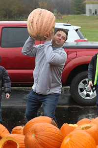 Candace H. Johnson-For Shaw Media Bill Snyder, of Mundelein throws one of his pumpkins into a dumpster to be used for compost during the Mundelein Park & Recreation District's Annual Pumpkin Drop at Keith Mione Community Park in Mundelein. The pumpkins were sent to Midwest Organics Recycling, out of Wauconda.(11/4/18)
