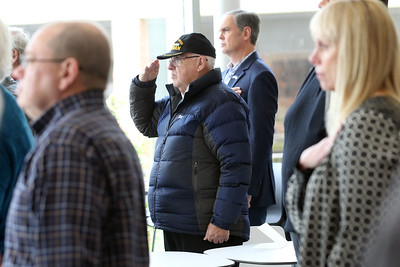 Candace H. Johnson-For Shaw Media Jim Reynolds, of Grayslake, (center) a Vietnam veteran, salutes during the National Anthem at the Veterans Day and Dedication Ceremony at the College of Lake County in Grayslake. (11/5/18)